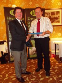 AGM 2016 - Wynne Davies presents David Alexander with a certificate for judging at the Royal Welsh Show.JPG