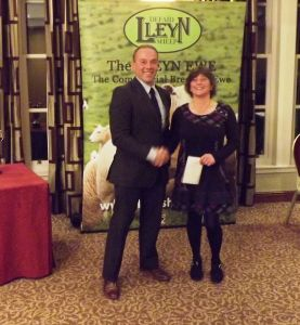 AGm 2017 - David Knowles presents Debbie McGowan with £250 vouchers as winner of the Photo Competition.JPG