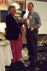 AGM 2015 - Gwenda Roberts presents Wynne Davies with the HE Roberts Memorial Trophy.jpg
