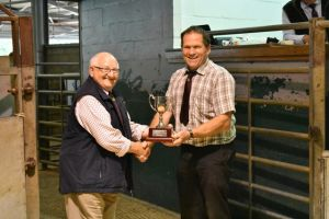 Ruthin 2018 - Society President Wynne Davies presents Lionel Organ with Champion Ram Trophy.JPG