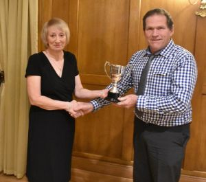 AGM 2018 - Sian Hughes presents Wynne Davies with the Morgan Evans Cup.JPG