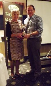 AGM 2015 - Patricia Baseley presents Wynne Davies with the Noel Baseley Memorial Show Points Cup.jpg