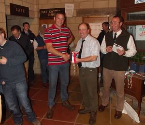 ROW 2015 - Judge Richard Twose presents Charles Geldard with the awards for ten shearling ewes and shearling ram.jpg