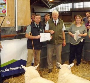 Carmarthen 2015 - Tefion Rees from For Farmers presents Dai Morris for Champion Ram.jpg