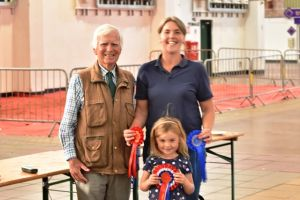 Exeter 2019 - The Parker Family being presented with champion females.JPG