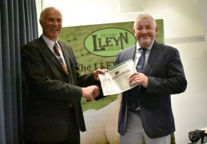 AGM 2019 - Derek Bond presents John Morton with judges certificate for the Balmoral Show.JPG