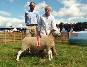 1st Prize Shearling Ewe and Overall Champion with Judge Brian Matthews.JPG