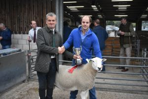 Welshpool 2018 - Judge Graham presents Terry Fort with Champion Ram.JPG