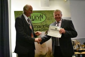 AGM 2019 - Derek Bond presents John Dugdale with judges certificate for the Royal highland.JPG