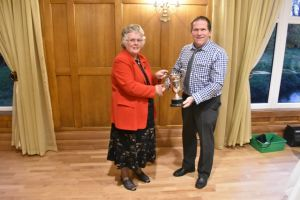 AGM 2018 - Gwenda Roberts presents Wynne Davies with the HE Roberts Memorial Cup.JPG