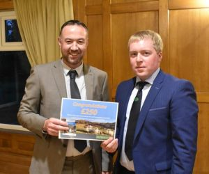 AGM 2018 - Photo Competition Judge Seamus Killen presents the Rumenco Vouchers to winner Andrew Kennedy.JPG
