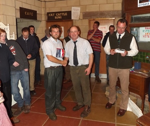 ROW 2015 - TP Radford is awarded with prizes for best ewe lambs pens of five & ten.jpg