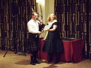 AGM 2017 - Euan Robertson entertained with the bag pipes.JPG